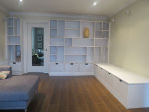 Living room built-in bookcases and storage units