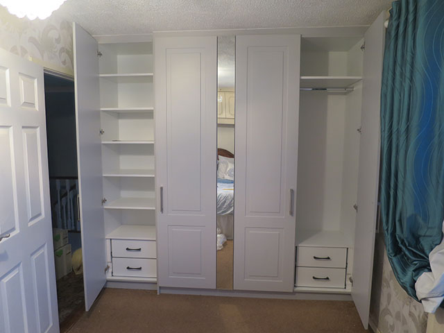 Interior of wardrobe showing drawers, hanging space and shelves
