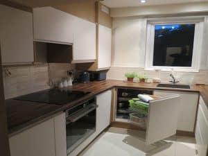 Kitchen with cupboard door open