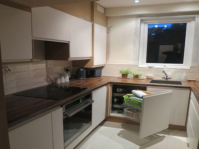 Kitchen with cupboard door open