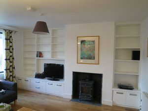 Living-room-media-unit-and-cabinets-beside-chimney-breast