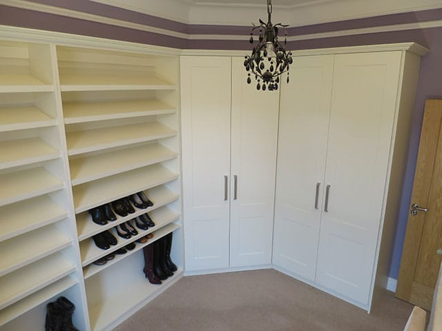 Wardrobes built around a corner and shelves for shoes