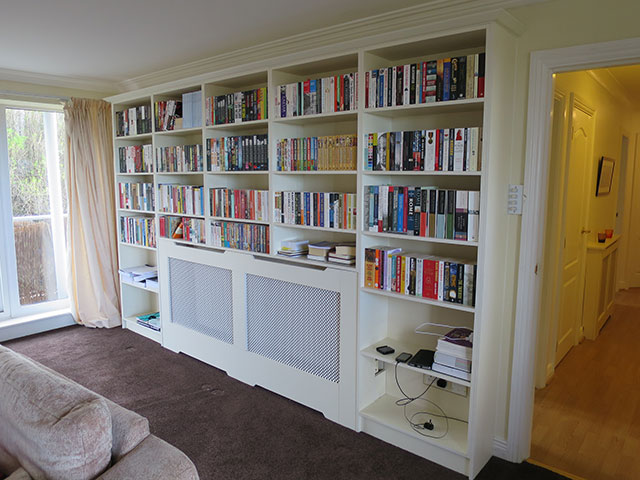 Book case with integrated radiator cover