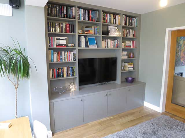 side view of bookcase and tv stand and cabinets