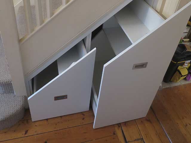 Understair storage open doors