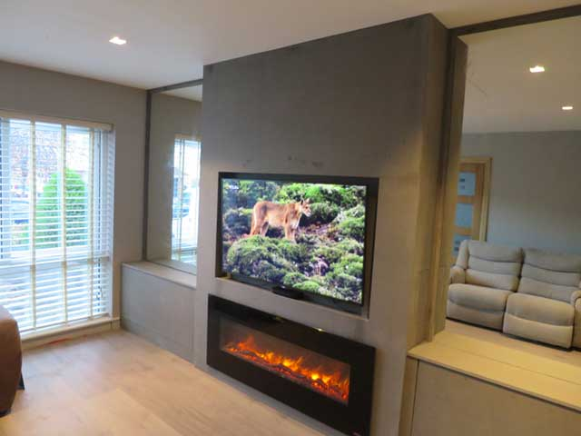 chimney breast with fire and tv and alcove units on either side