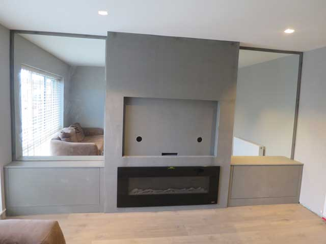 chimney breast and alcove units on either side in construction