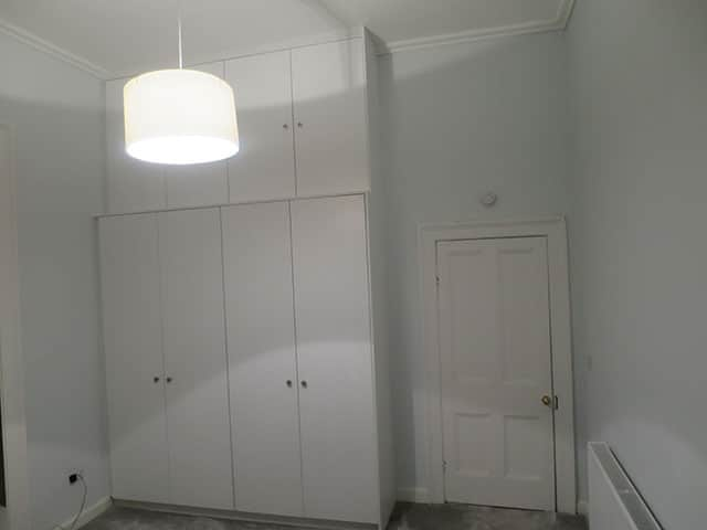 Wardrobe with storage on top for room with high ceiling